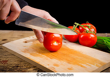 Cut tomato on wooden cutting board - Cut tomato with kitchen...