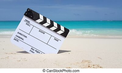 Maldives beautiful beach background white sandy tropical paradise island with blue sky sea water ocean 4k clapperboard film slate action cut