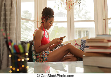 Young Black Woman Texting On Phone And Smiling - Black girl...