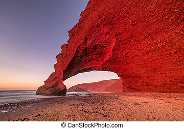 Red arches of Legzira beach - Sunset at red arches of...