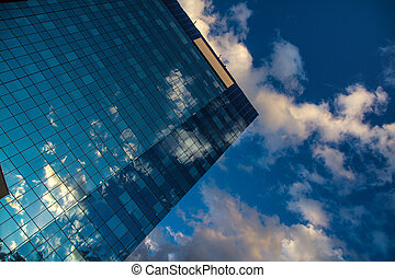 Reflected clouds in the mirror of skyscrapper