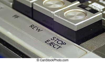 Finger Presses Stop Control Buttons on Audio Cassette Player...
