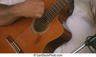 Spanish guitarist. - A latin performer plays an acoustic...