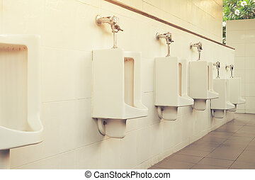 Urinal Tile Wall - Row of white urinal for men on tile wall...
