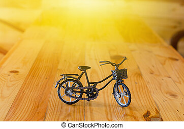 Small  toy, bicycle model on wooden background