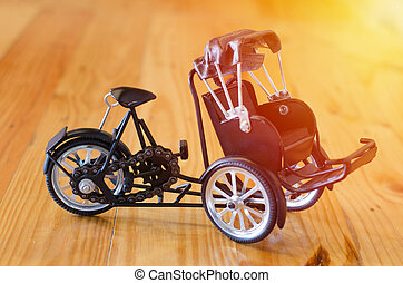 Small wooden toy, three - wheeler tricycle taxi model on...