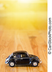 Small  car, bicycle model on wooden background