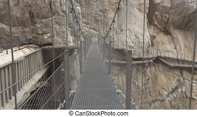 Walking on 'El Caminito del Rey' final bridge - A tourist...