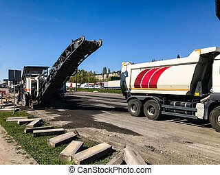 Large-scale repair work with large machinery on the highway...