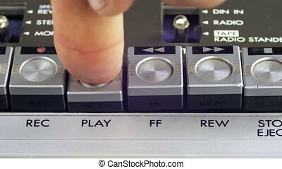 Pushing Play and Stop Button on a Vintage Tape Recorder