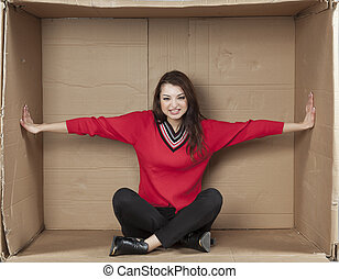 business woman sitting in a cramped office