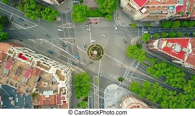 Roundabout in Barcelona, aerial rising shot, top view. 4K...