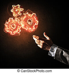 Concept of teamworking or organization presented by fire glowing