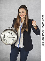 time is power, business woman and her gesture of success