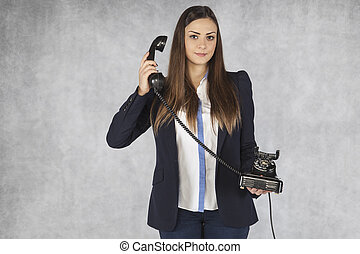 business woman listens to a customer on the phone