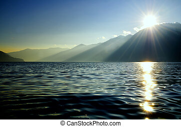 Alpine Lake in sunset with mountain - Alpine lake Maggiore...