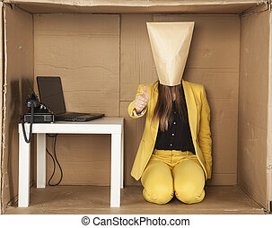 business woman in a minimalist office shows the thumb upwards