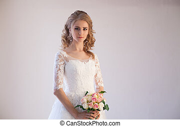 bride in wedding dress with a bouquet of flowers