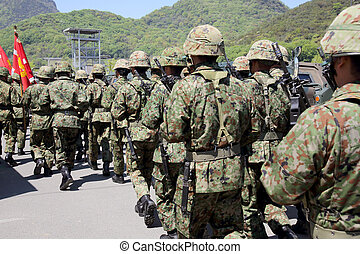 Japanese soldier marching orders at the military base -...