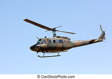 Japanese military helicopter in flight