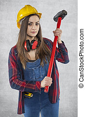 Portrait of construction worker with big hammer