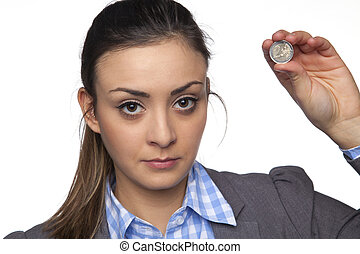 Young beautiful business woman shows two euros