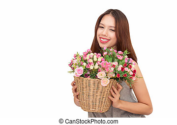 Girl holding a basket of flowers.