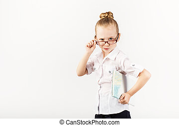 Funny smiling little girl imitates a strict teacher against white background.