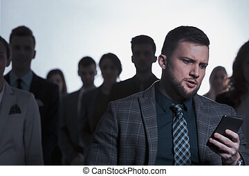 Businessman checking his phone - Nervous young businessman...