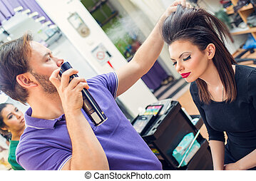 At The Hairdresser's - Man hairdresser spraying long...