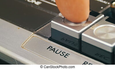 Pushing Pause Button on a Vintage Tape Recorder. Close-up....