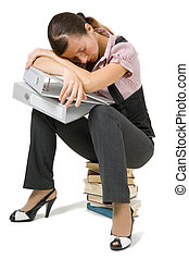 young girl asleep sitting on the books on an isolated...