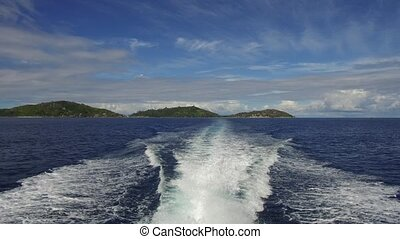 indian ocean and leaving boat trace on water - travel,...