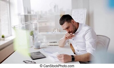 businessman with tablet pc and papers at office - business,...