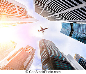 Business towers and aircraft - Business downtown skyscrapers...