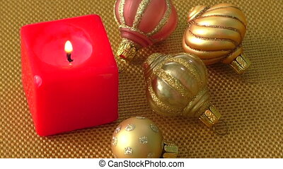 Red christmas candle and christmas ornaments