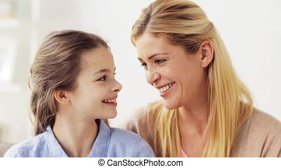 happy mother and girl looking at each other - family,...