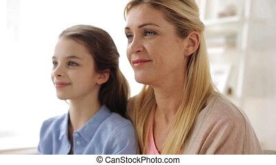 happy smiling mother and girl at home - family, generation...