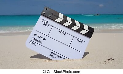 Maldives beautiful beach background white sandy tropical paradise island with blue sky sea water ocean 4k clapperboard film slate action cut director