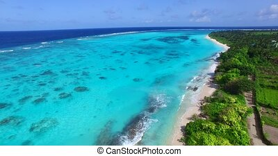 Maldives beautiful beach background white sandy tropical paradise island with blue sky sea water ocean 4k aerial drone flying flyover birds eye