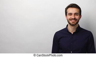 Confident business man smiling at camera - Young successful...