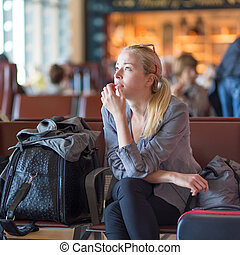 Woman waiting on airport terminal.
