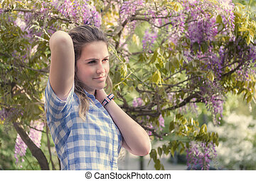 Spring beauty girl outdoors. Toned image