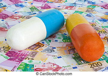 Health costs - Pills on Euro banknotes as background