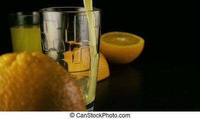 Slow mo. Fresh orange juice pour into a glass
