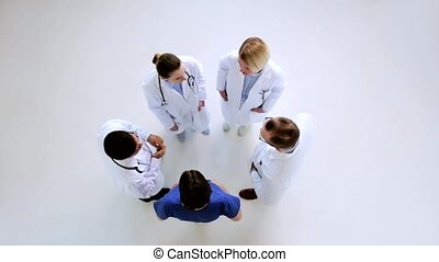 group of doctors talking at hospital