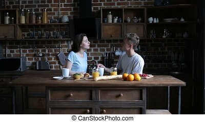 Couple getting ready for day with morning coffee - Young...