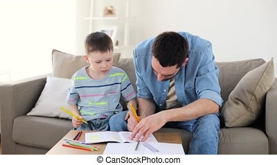 father and son drawing and doing high five at home - family,...