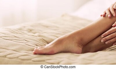 beautiful woman with bare legs on bed at home - people,...