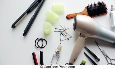 hair styling devices on white background - beauty, haircare,...
